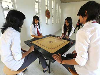 art and design students playing carrom