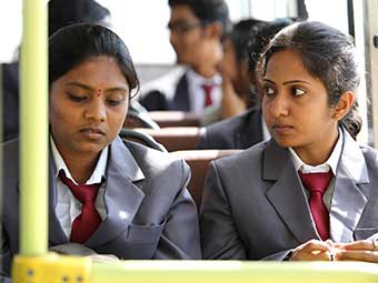 students traveling at vogue college bus